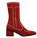 Suede boots with metal rivets, $1,100.