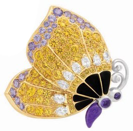 A butterfly brooch that is part of  a bigger floral clip