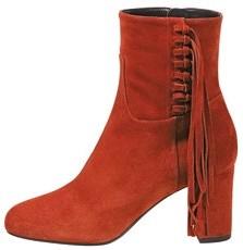 Velvet boots, $1,010, Longchamp.
