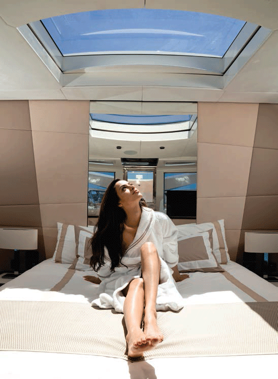 <b>This page: The iconic master suite has steps up to the foredeck and a large skylight.</b>