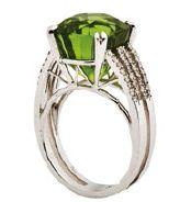18K white gold ring with diamonds and peridot, $12,000, Confetti by Mui.