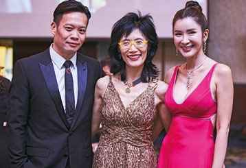 15. Socialite Jamie Chua (right) with partner Terence Koh, and friend.