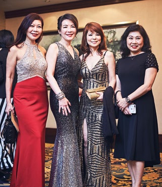 7. Belinda Bay (third from left), general manager, Performance Motors, with friends.