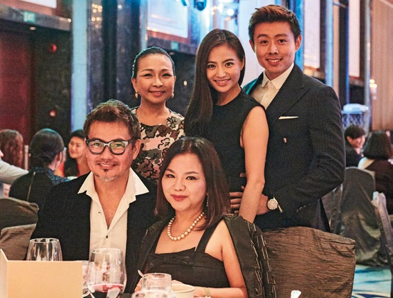 9. Front row: Mervin Wee with his wife, beauty maven Jean Yip. Back row, from left: Dawn Yip, actress Cheryl Wee, and her husband Roy Fong.