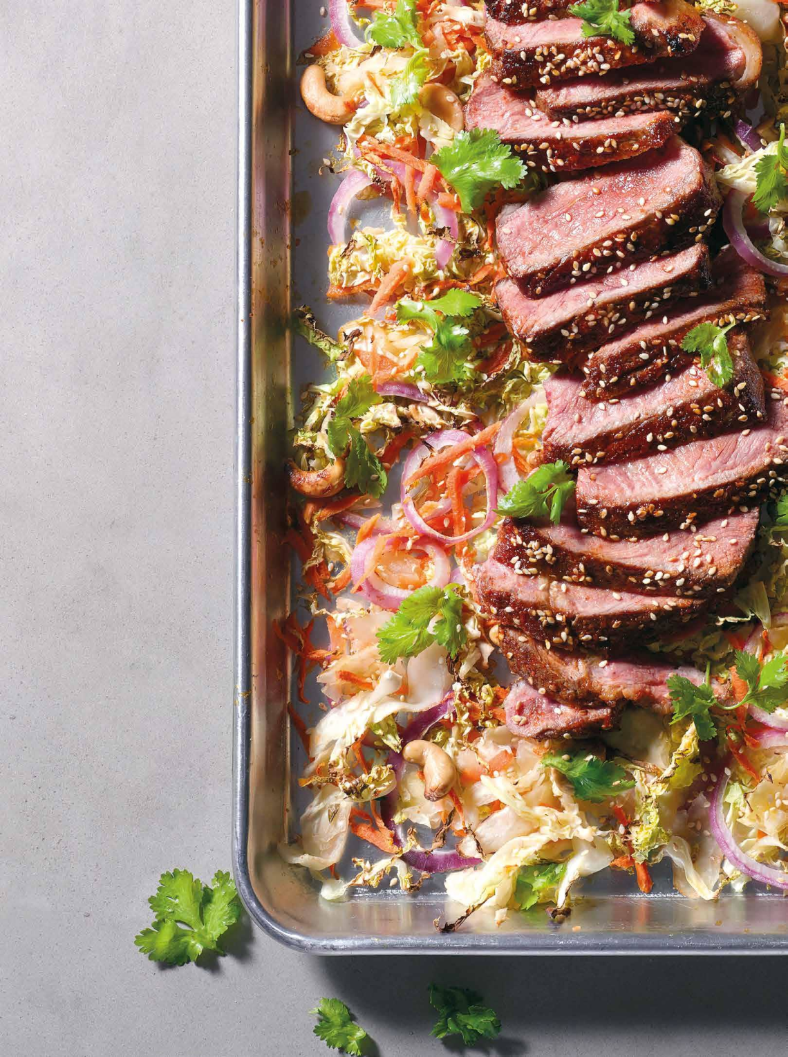 SESAME STEAK WITH CABBAGE, CARROTS, ONIONS, AND KIMCHI