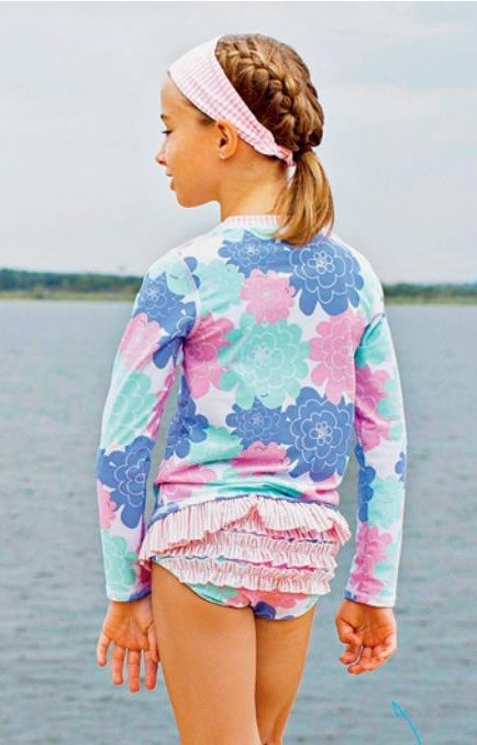 Petals long-sleeved rash guard, $49.90, from www.baby-beachbums.com