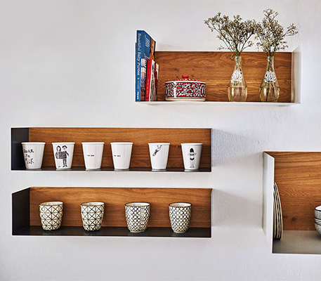 Simple wall displays give the dining room an understated charm.