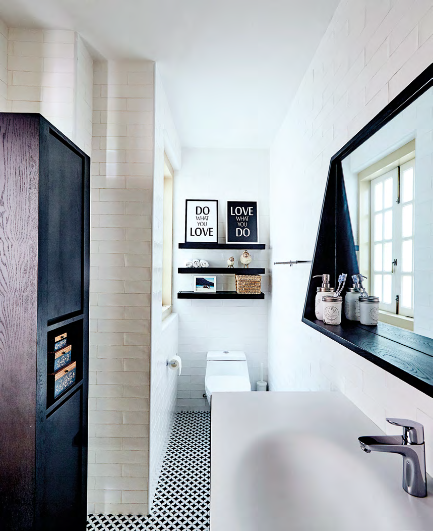 The black-and-white colour scheme of the bathroom is inspired by the colonial bungalows that the couple love.