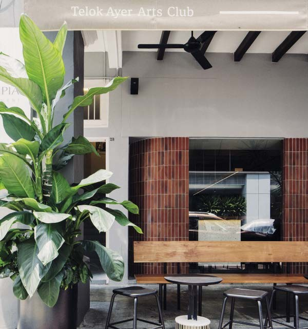 Curvy silhouettes are a common element in Modernist architecture. Such a feature was chosen for this space (pictured right), to  create a welcoming entrance. The inaugural show was titled In-inhabitations by artist Abigail Goh, which was an aural and visual commentary on the actual renovations that took place at the site on which the club now resides.