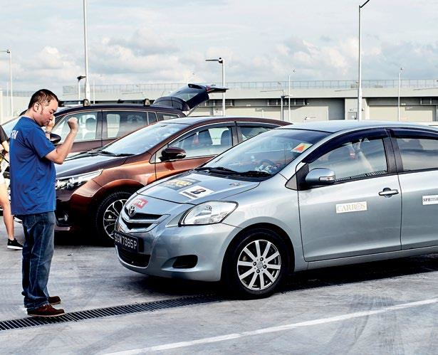 """Torque's senior writer Jeremy Chua (left) tried to give a """"learner driver"""" some parking lessons."""