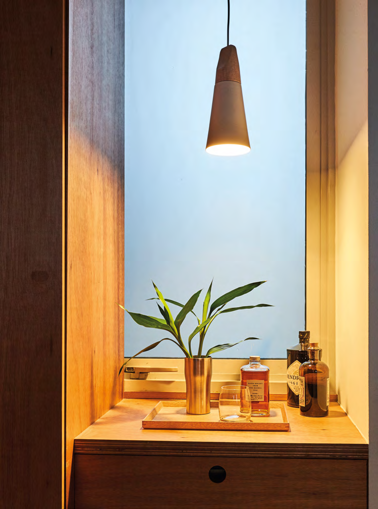 The exposed plywood and chic whisky bottles create an interesting look