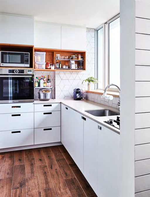 For a sense of design continuity, the kitchen also features exposed plywood cabinetry.