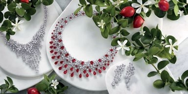 From top: The collection  features rubies, emeralds,   sapphires and diamonds. White gold, emerald  and diamond Carissa necklace, Gra