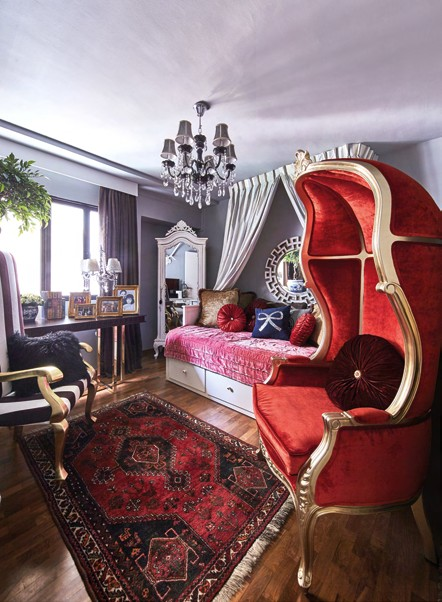 The guestroom is complete with high-back chairs in velvet finishes and bright hues like red and gold.