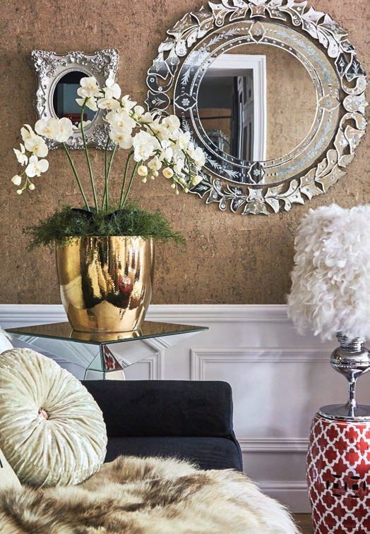 Ivanna styled the living room beautifully with a selection of decor including intricately designed mirrors, accompanied by cushions, throws and side tables.