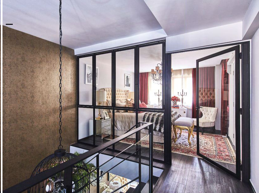 """""""This is my favourite — yet most expensive — part of the home,"""" Ivanna shares of the master bedroom design, which showcases black framed glass doors that replaced original walls. """"We needed several approvals for constructing the window panels and door, and that added to the costs,"""" she adds."""